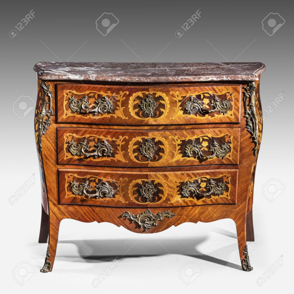 47681104-old-vintage-antique-chest-of-drawers-known-as-commode-wood-inlaid--Stock-Photo.jpg